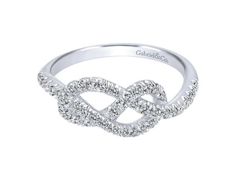 14k white gold pave set diamond knot ring.  The total carat weight of these diamonds is 0.39ctw s845626