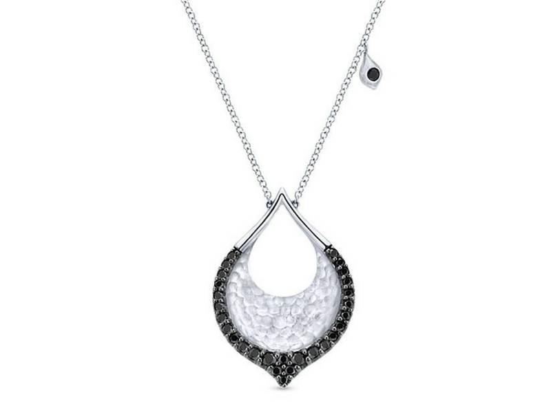 Sterling silver pendant.  This pendant contains round black spinel.  The total carat weight of these spinel is 0.59ctw