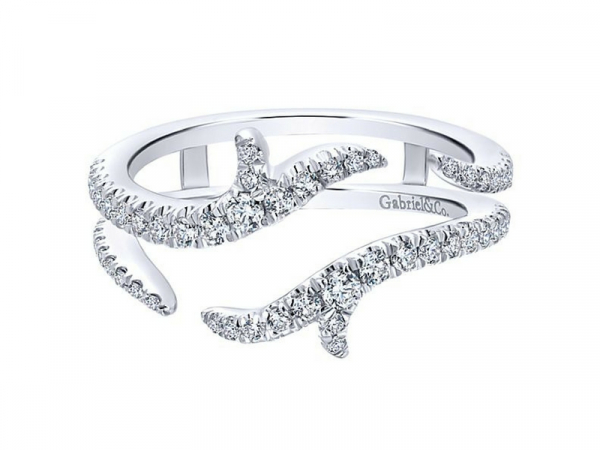 14k White gold Round Diamond Enhancer.  Tapered tendrils of French pave diamonds curve alluringly around your engagement ring when you add this enchanting ring jacket.  The total carat weight of these diamonds is 0.42ctw.